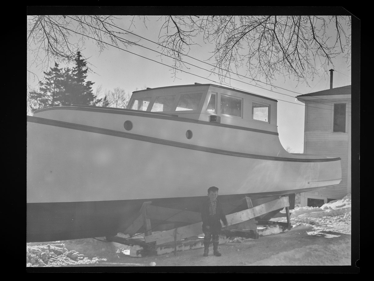 State Patrol Boat in Rich-Grindle Yard with Boy Negative, 1948 (1)